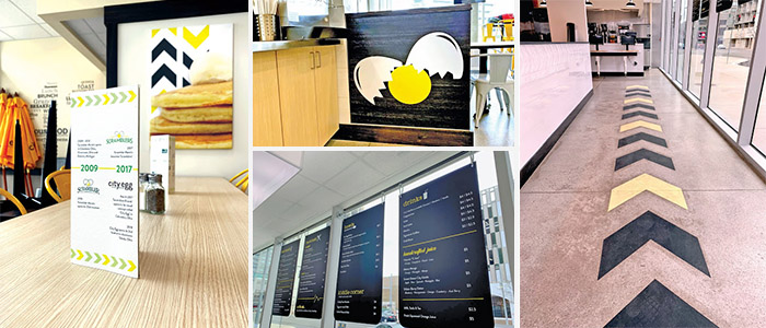 Brand-consistent floor graphics, hanging signs, and stand up signs
